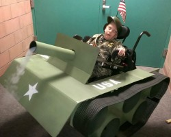 Step-Dad makes his Son's Wheelchair into a Tank for Halloween