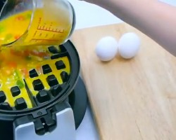 When She Pours Eggs In The Waffle Iron, Something Awesome Happens